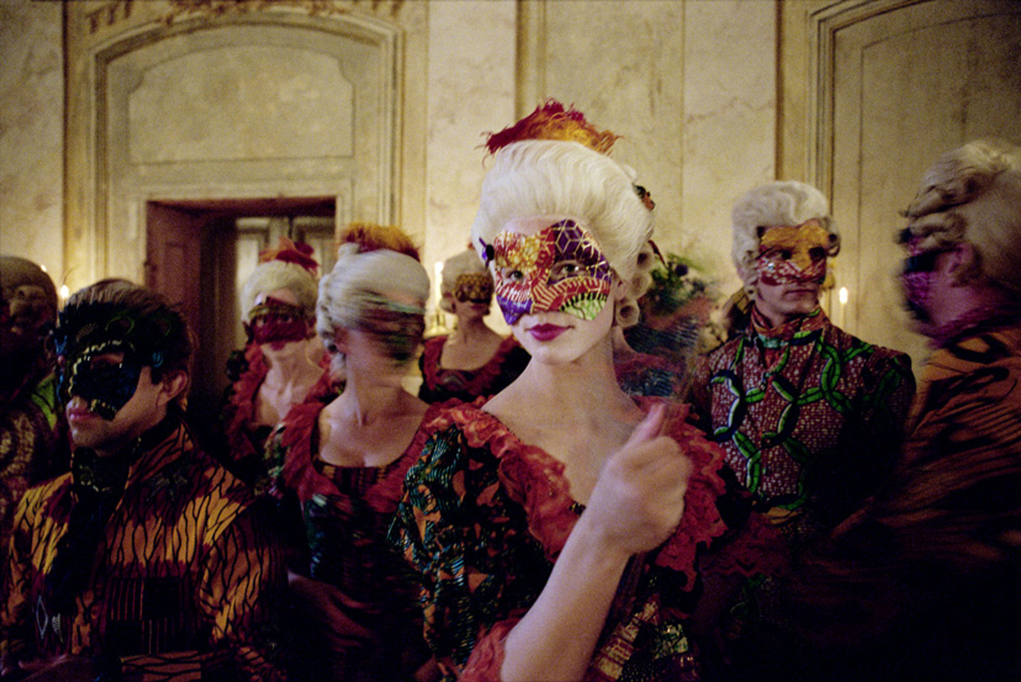 A masked woman at a masquerade