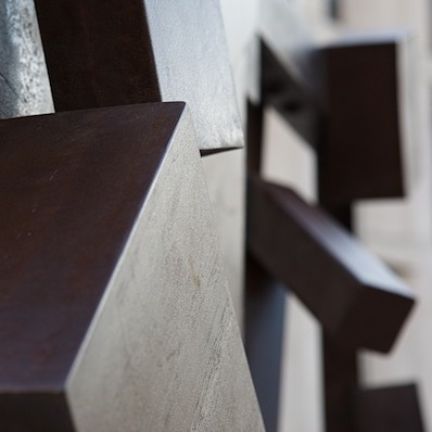A brown rectangular sculpture cocked at an angle