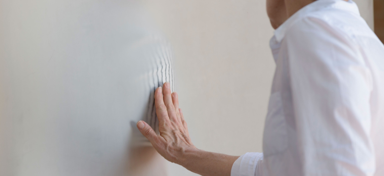 A woman touching a screen