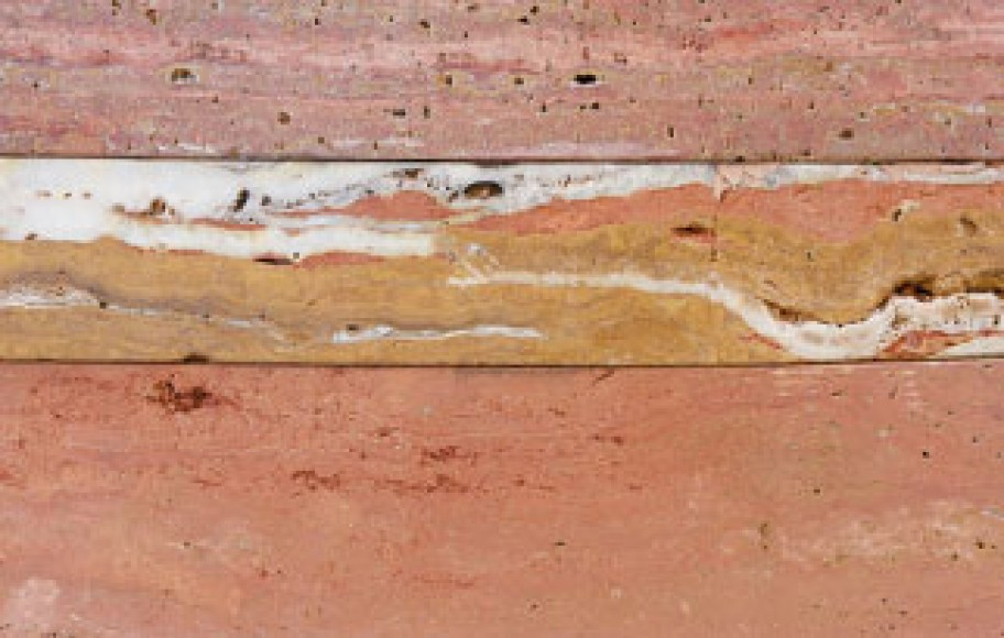 detail of stone sculpture with mineral striations
