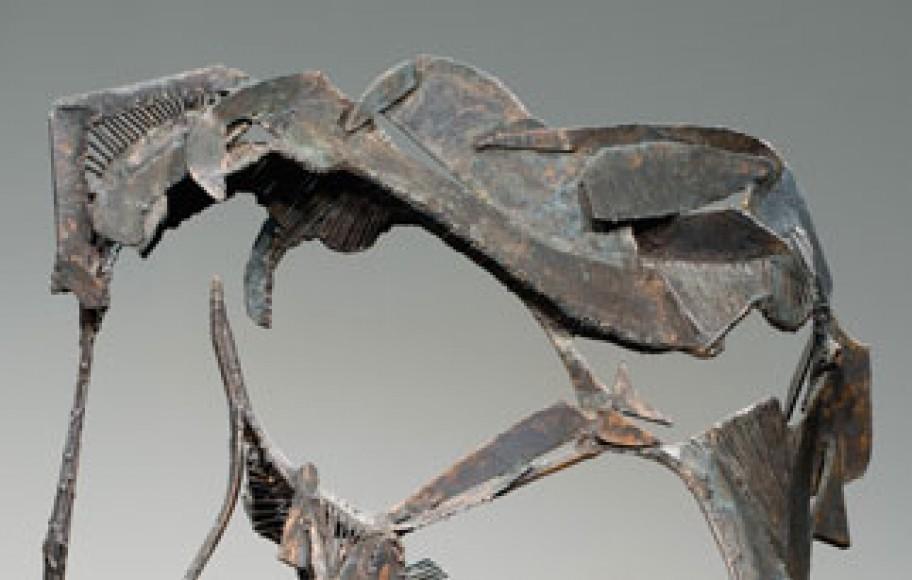 detail of metal sculpture of swan