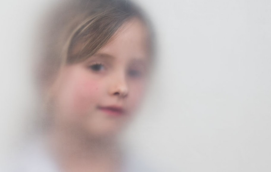 A girl in hospital garb