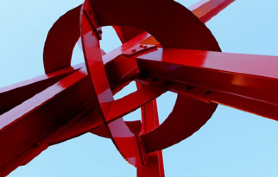 A large red sculpture made out of metal