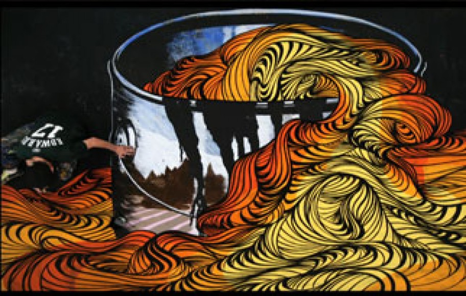 A giant paint bucket with pasta coming out of it