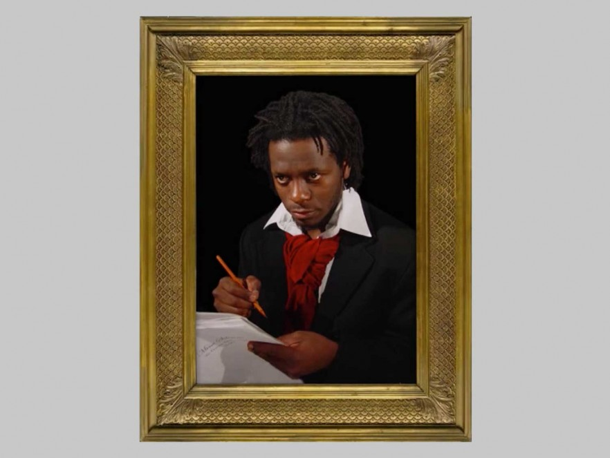 A picture frame around a man holding a writing utensil