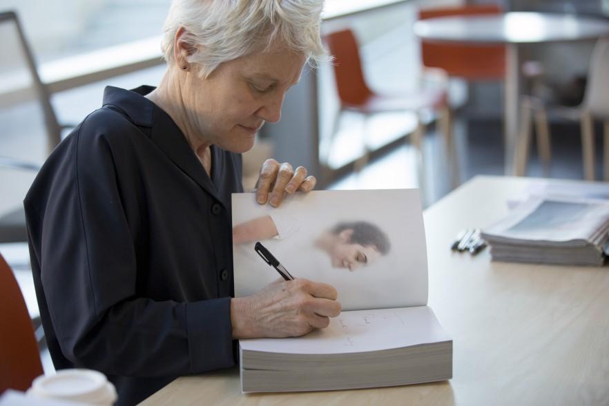 Artist Ann Hamilton signing a book