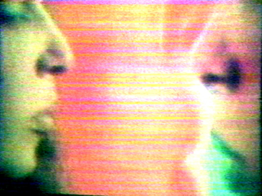 Film still with profiles of two people