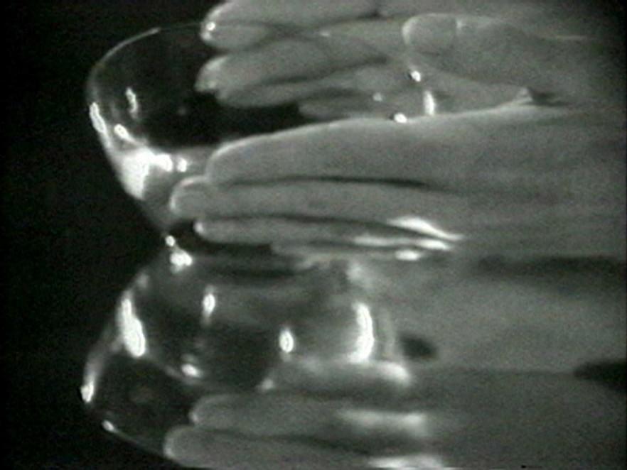 Hands around a glass bowl