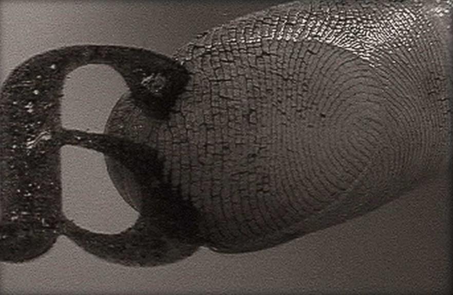 A fingerprint on a backward cutout of the letter A