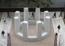 A circular structure with towers made of concrete blocks