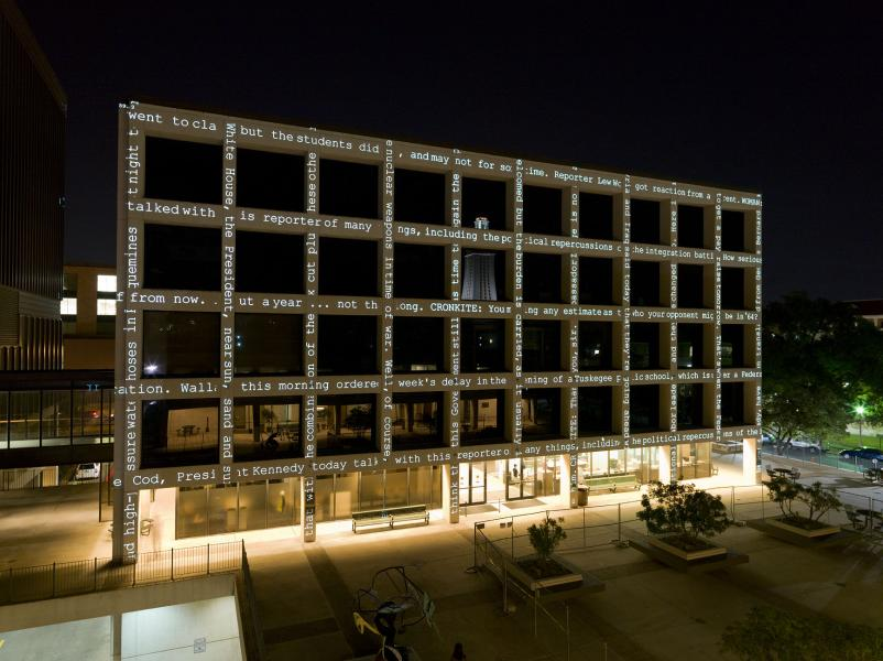 A grid-like building face with text running vertically and horizontally
