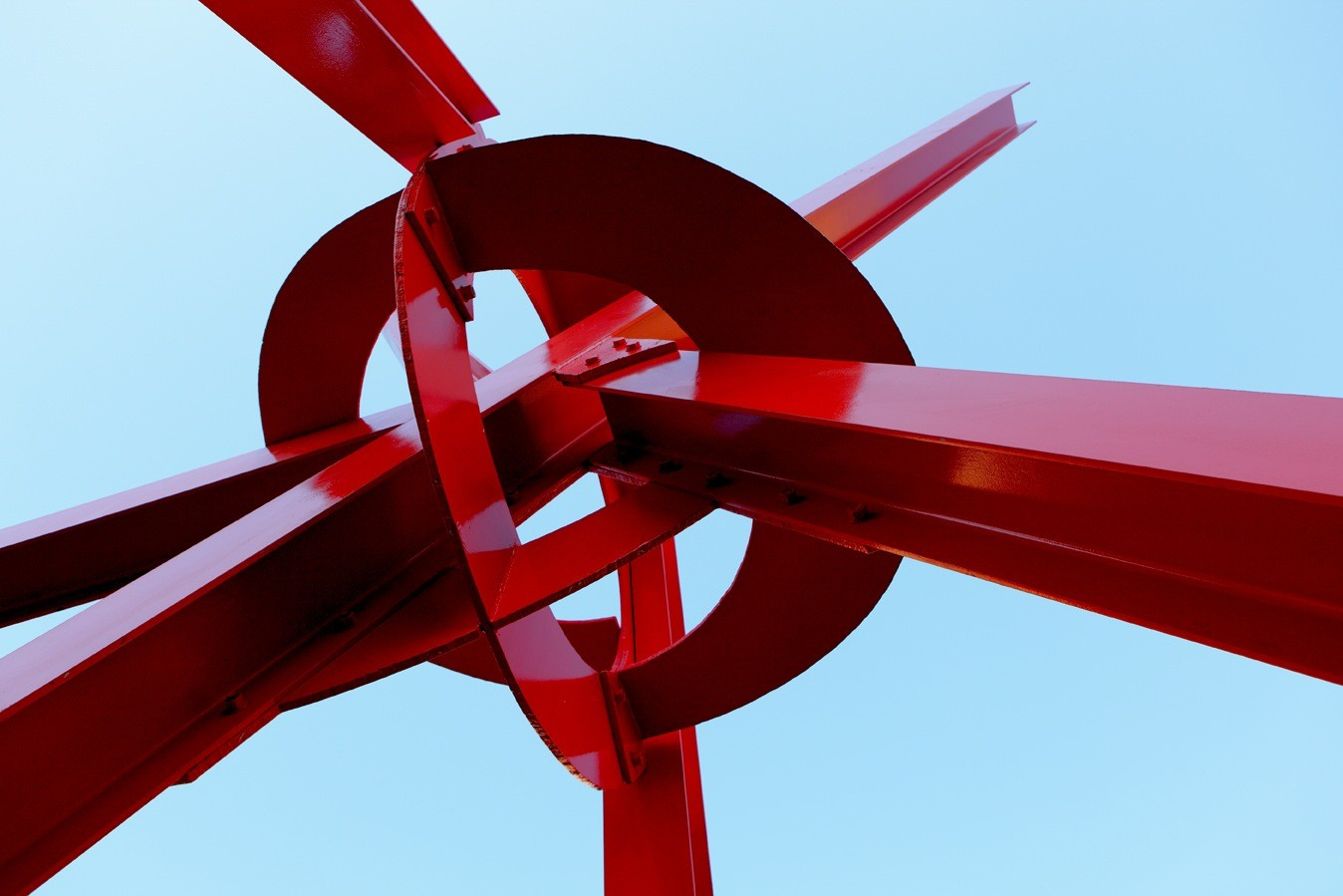 A large sculpture in front of a blue sky