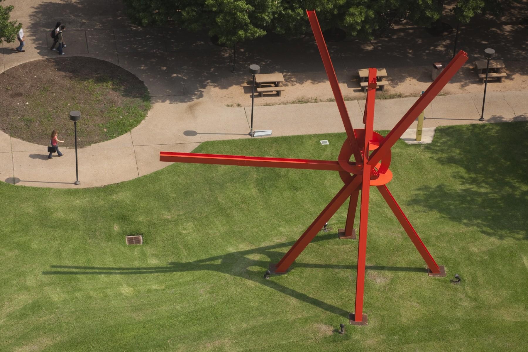A large sculpture on green grass