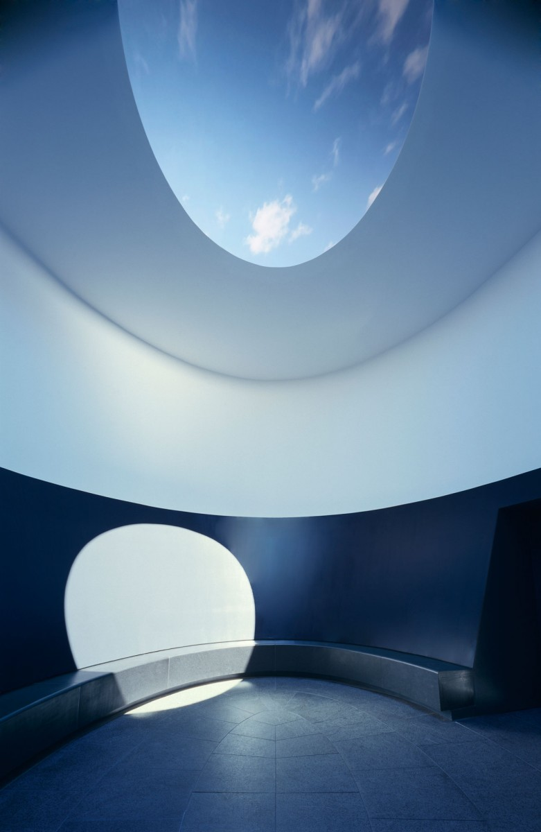 Lighting shining through an oculus into a cylindrical room