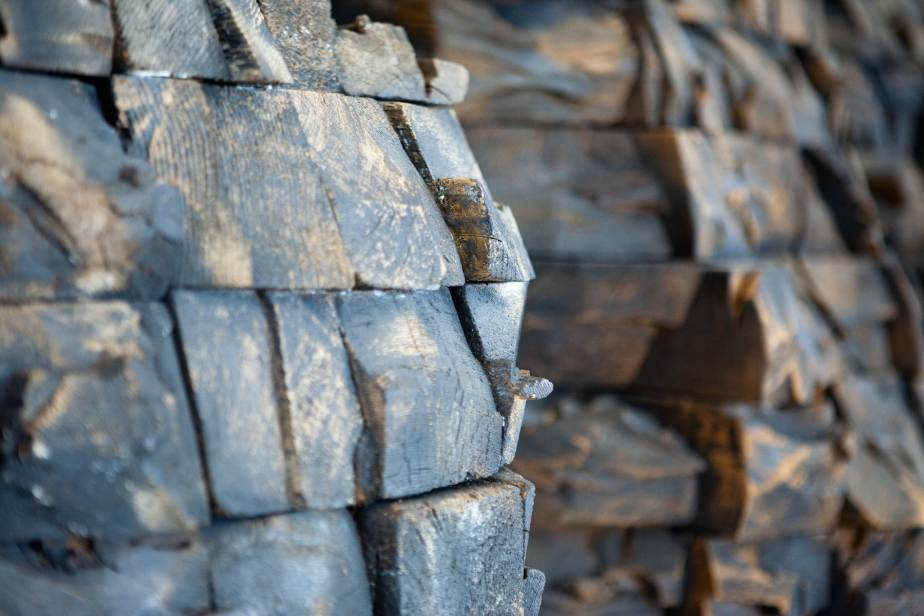 Detail of seven mountain shaped objects made from wood blocks