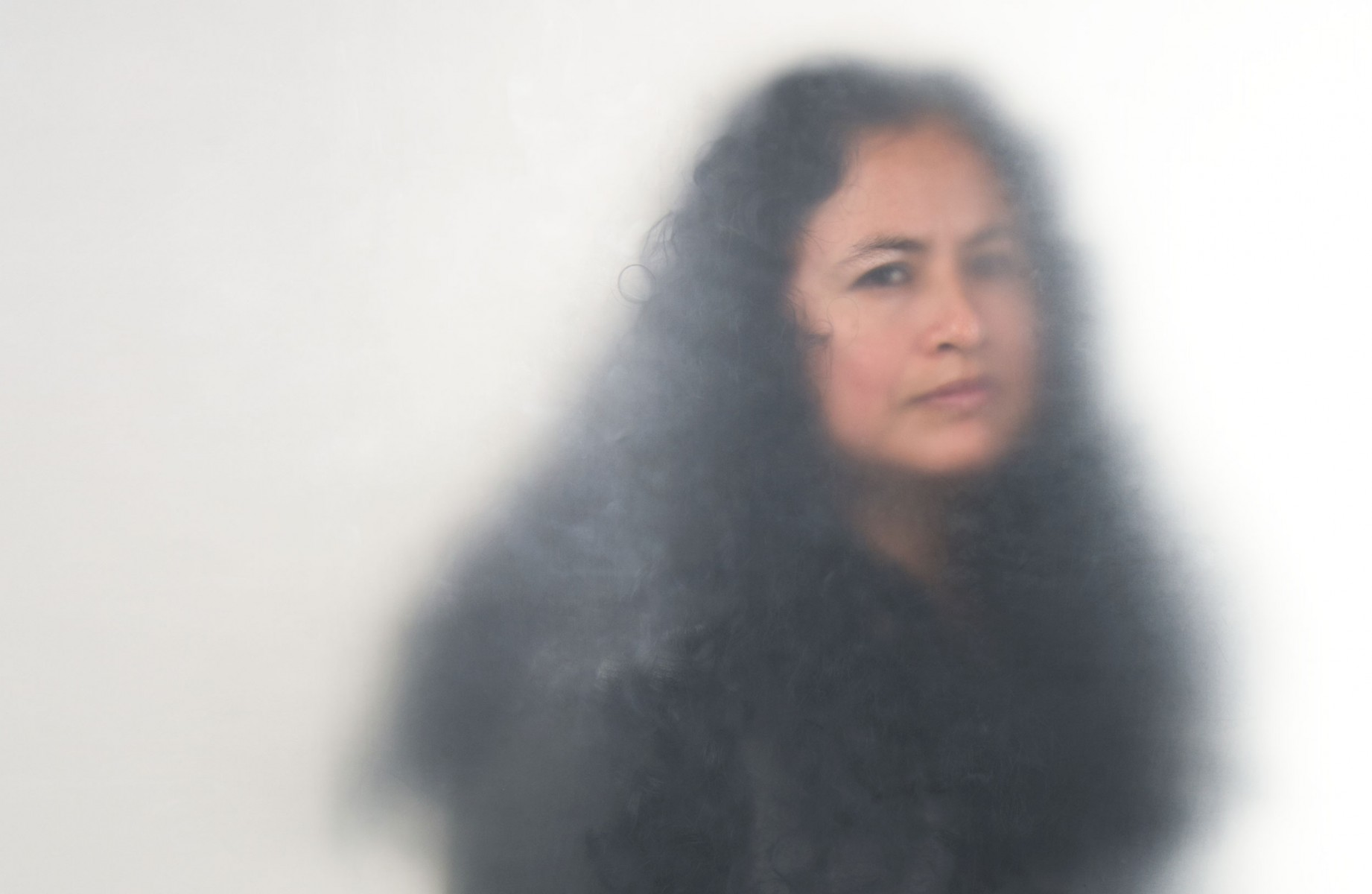 A woman with wavy black hair