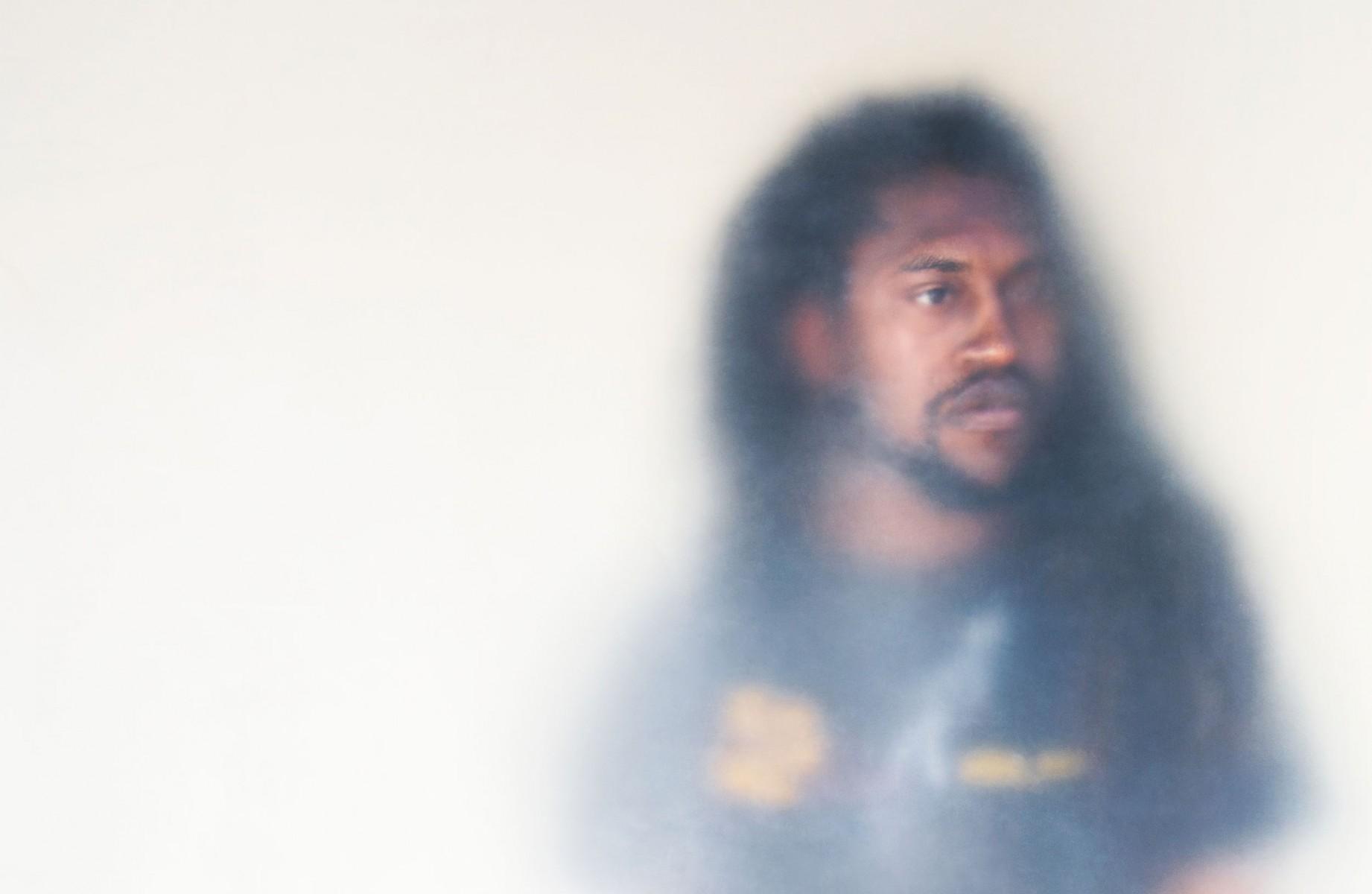 A man with long black hair