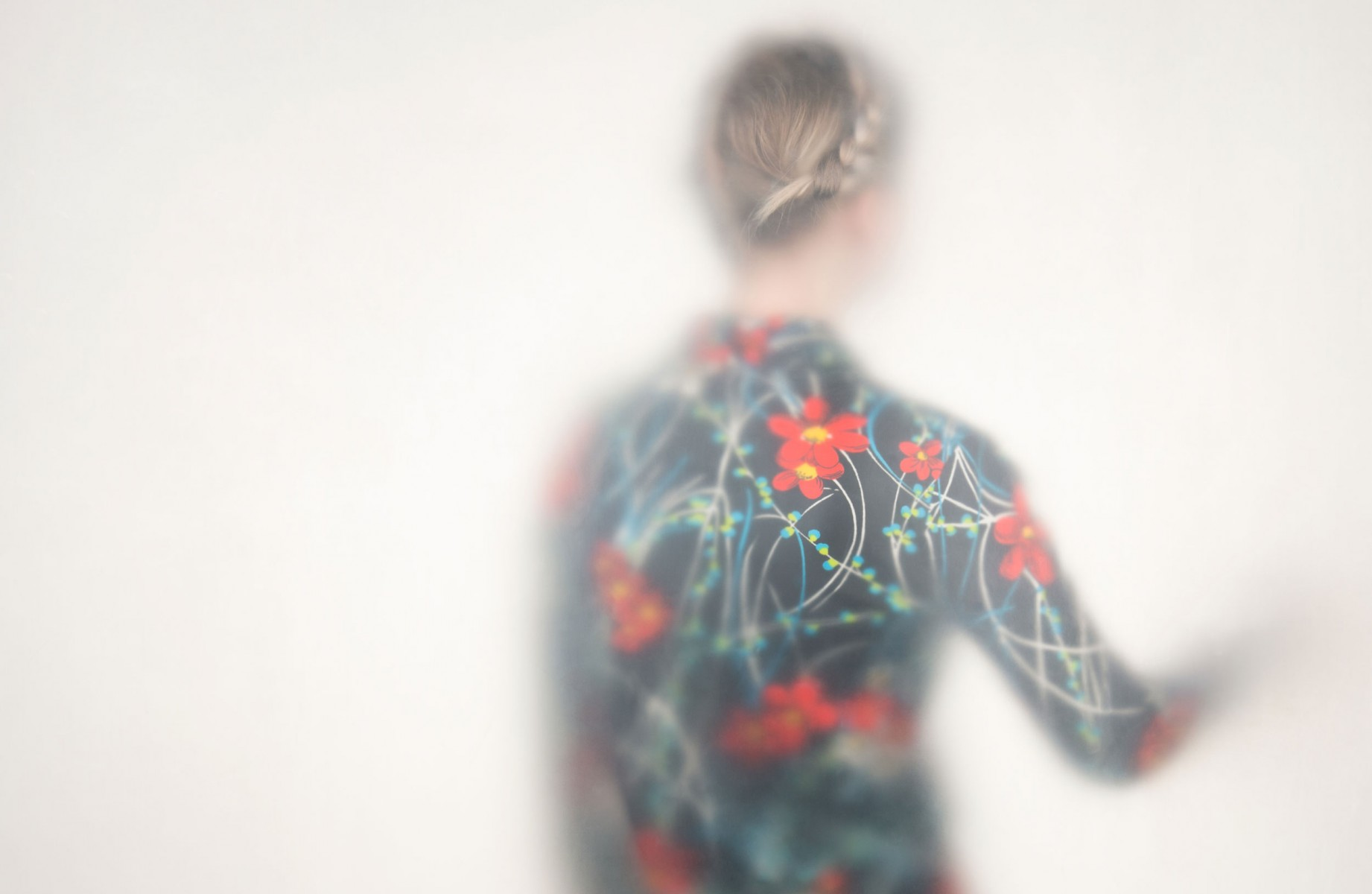 A woman in a patterned shirt