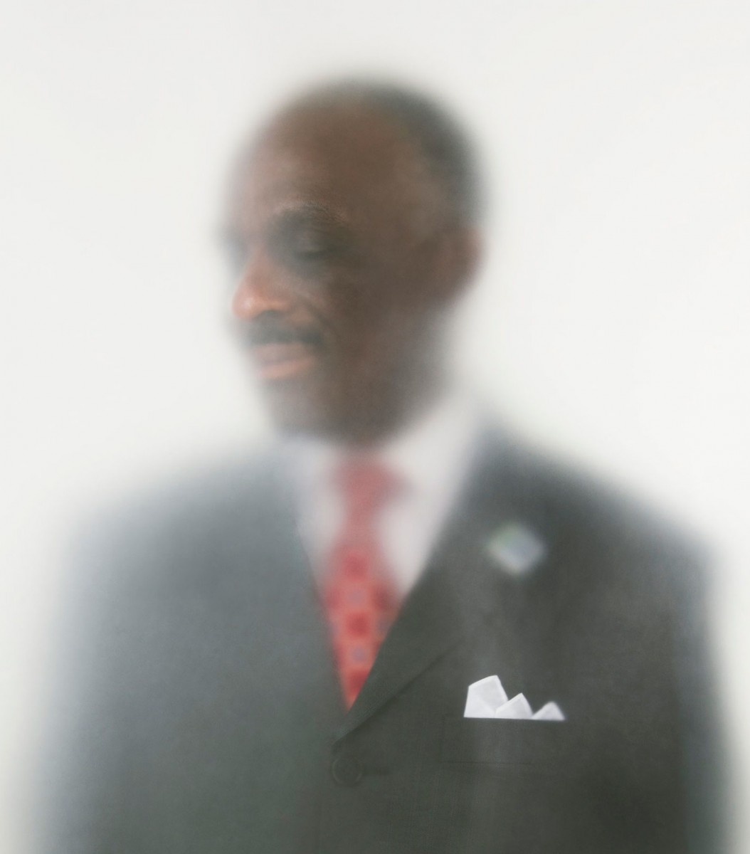 A man wearing a suit with a red tie