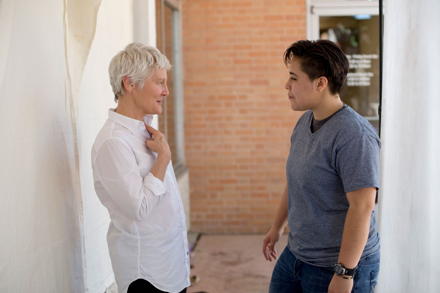 A woman talking to another person