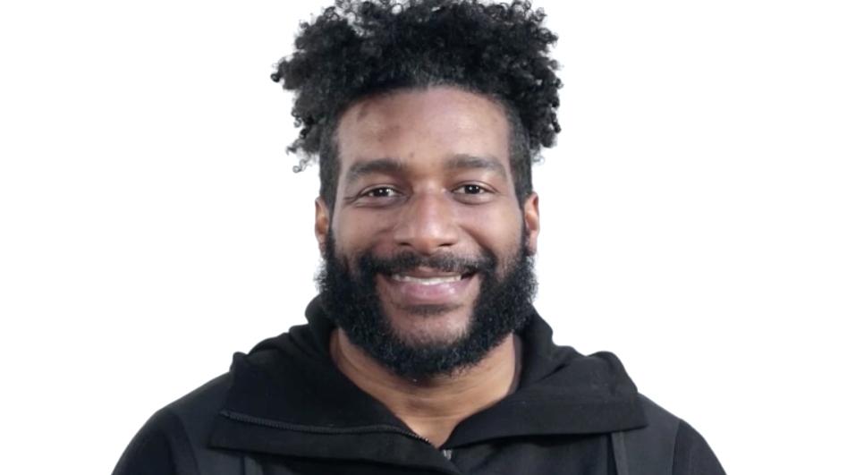 One man smiling