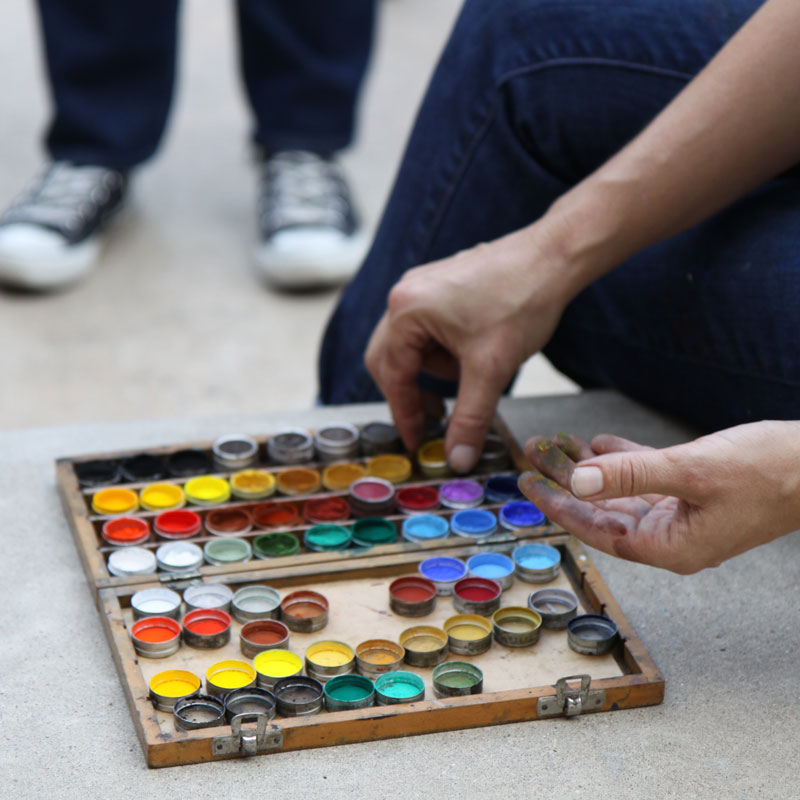 A selection of paints in a small wooden box