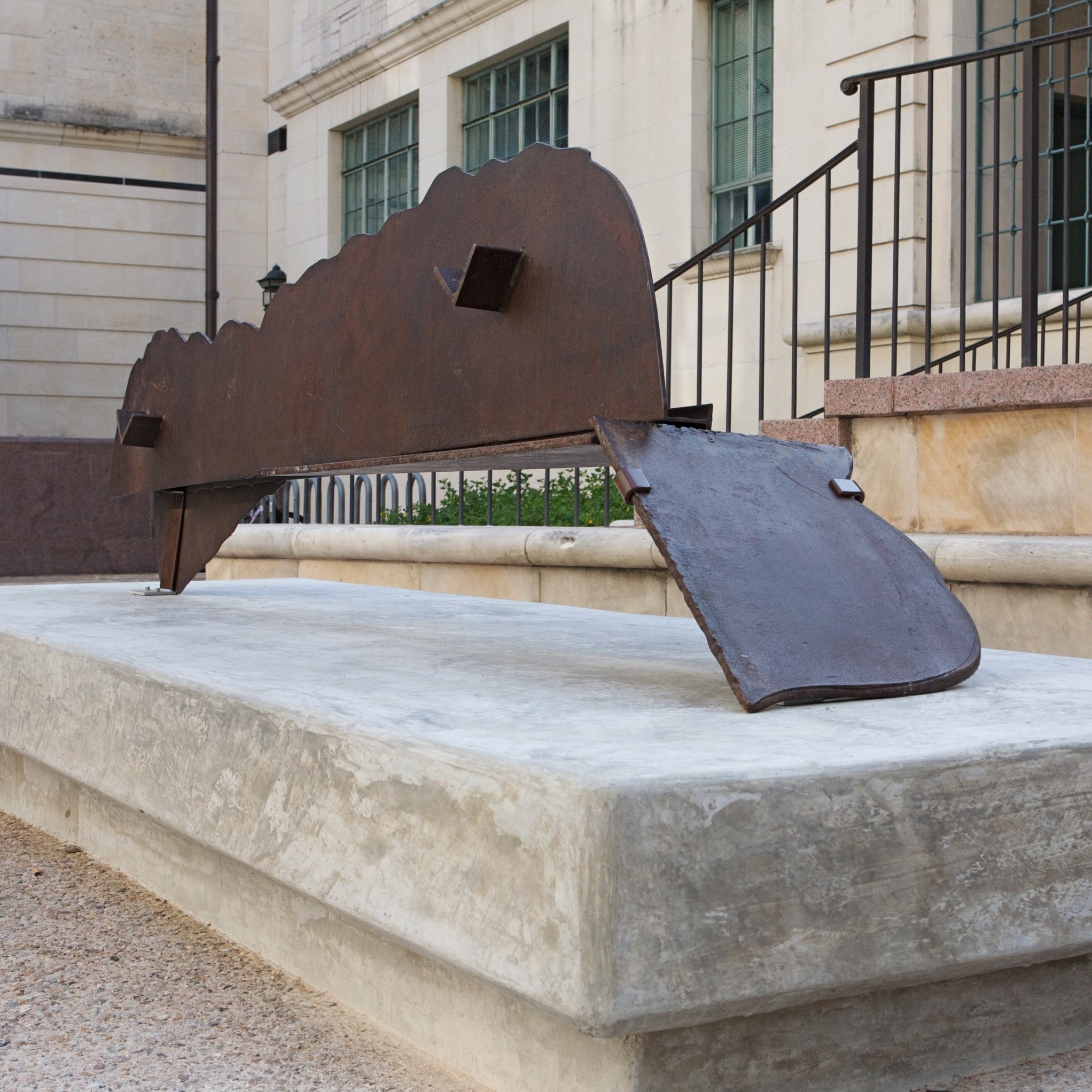 A horizontal steel sculpture which