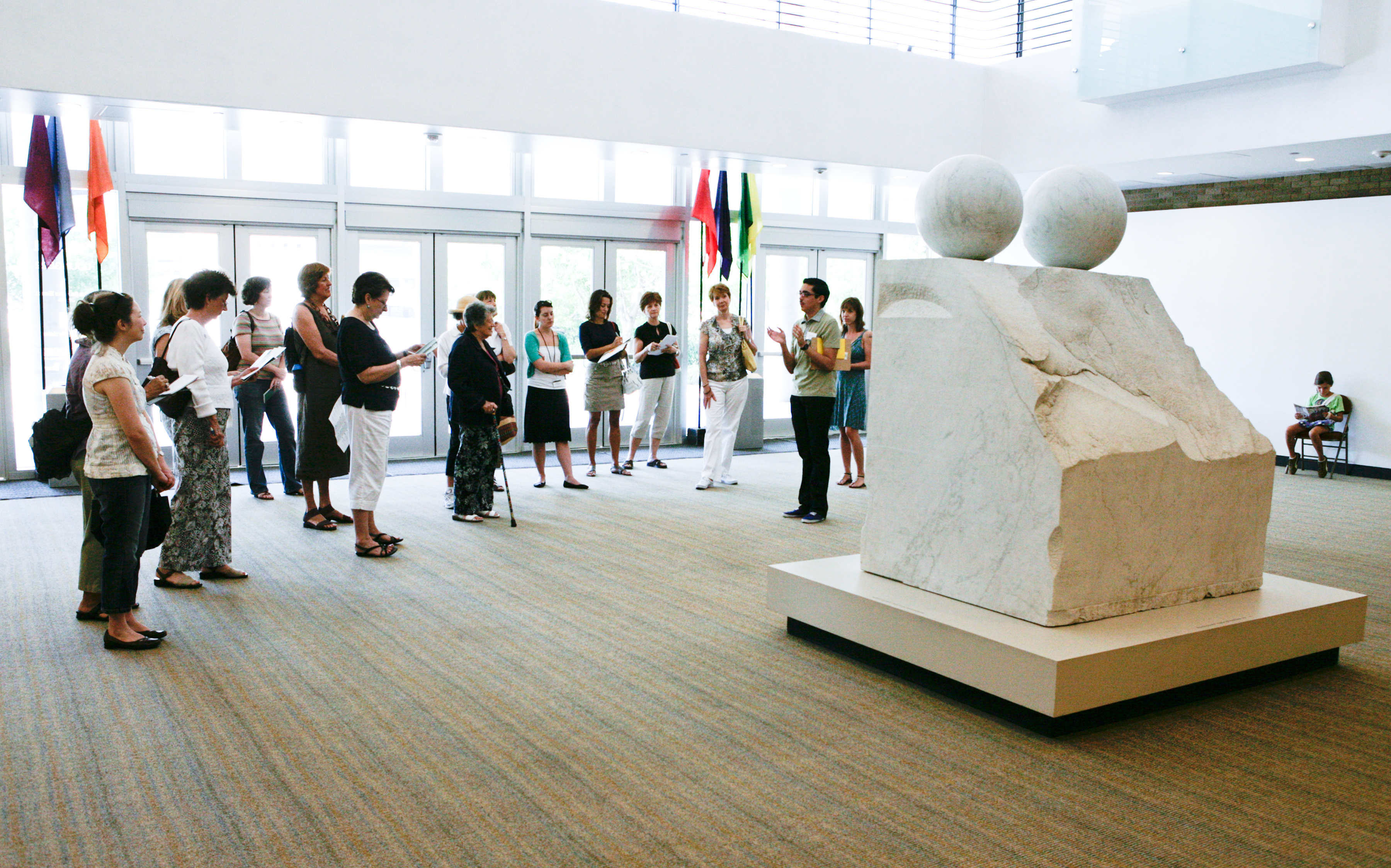 A docent tour surrounding Louise Bourgeois' sculpture