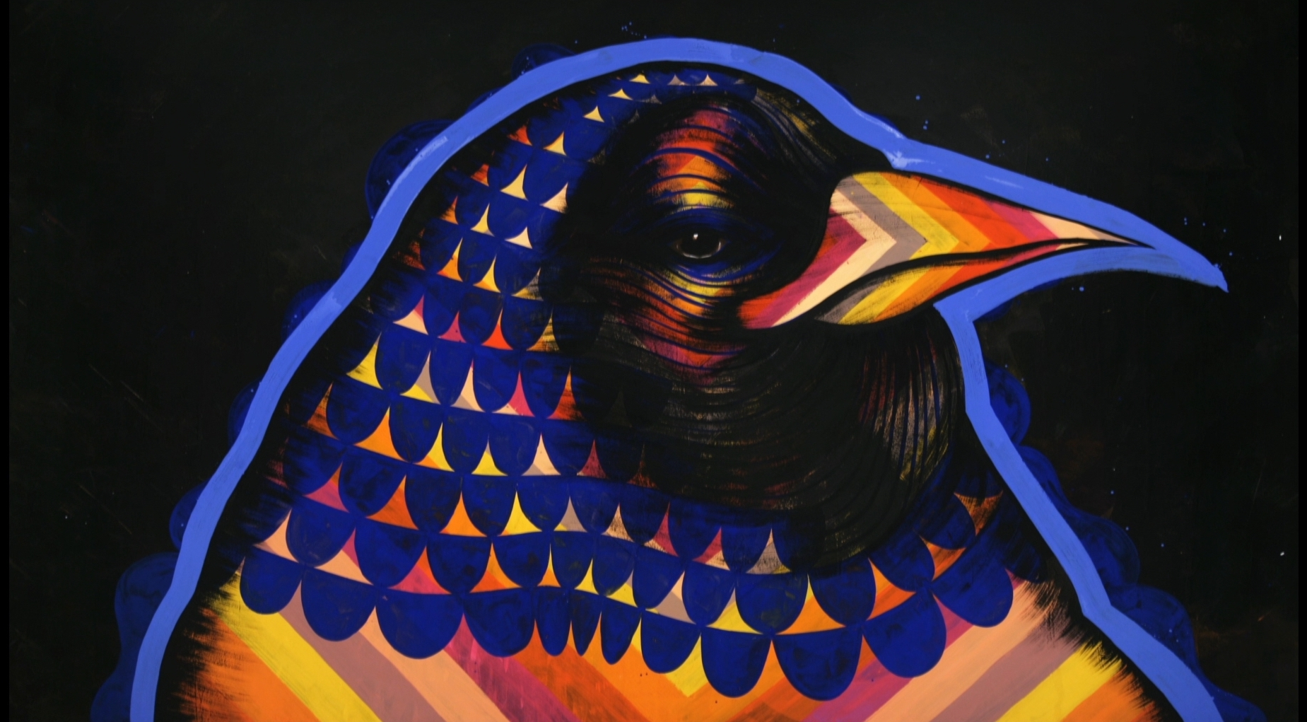 """A still from David Ellis' """"Animal."""" In this still a chicken in profile composed of bright colors and a pattern covering its body seems to be staring at the camera"""