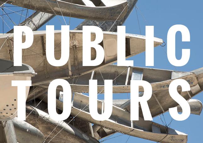 detail of sculpture with public tours text