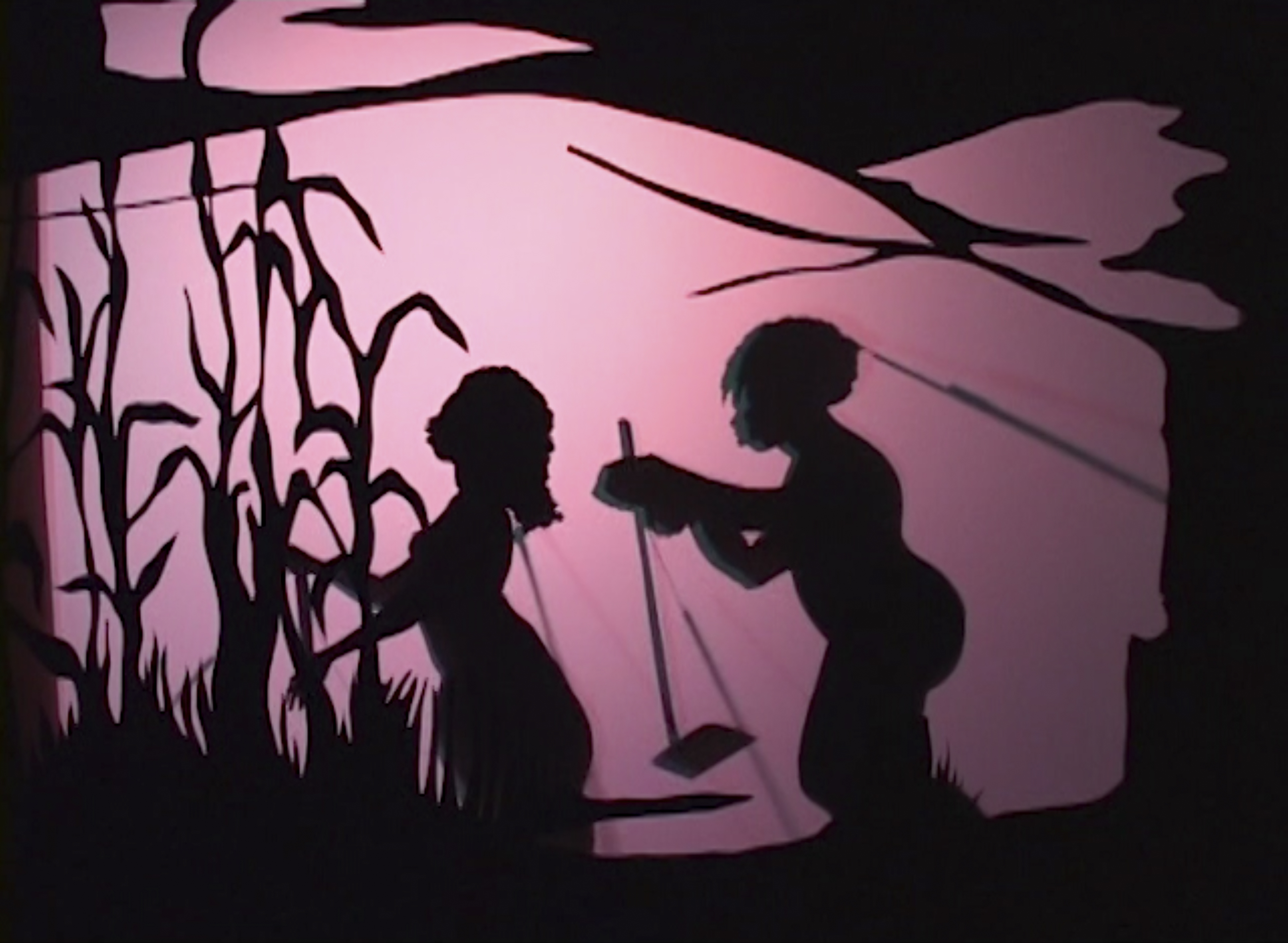 silhouette of two people walking in front of a pink background