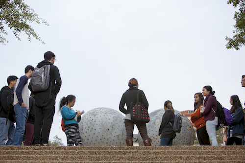 Students in front of sculpture
