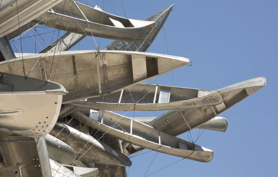 A large metal sculpture of boats