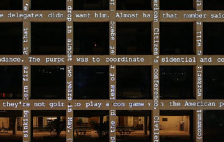 projection with words on the exterior of a building