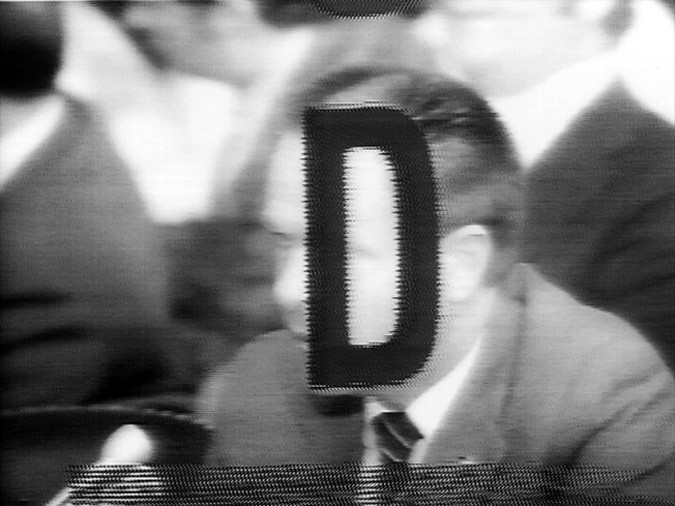 "image of a man's face with the letter ""D"" superimposed"