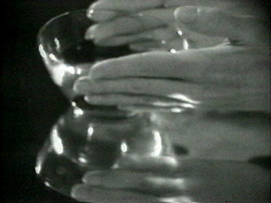 Hands around a glass bowl