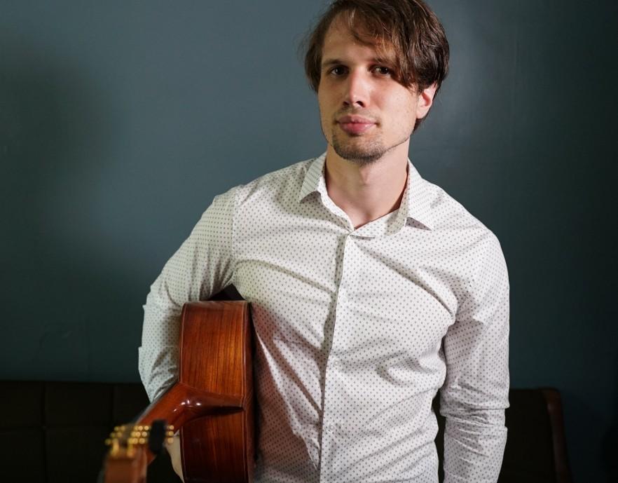 Headshot of Austin-based composer, Matthew Lyons