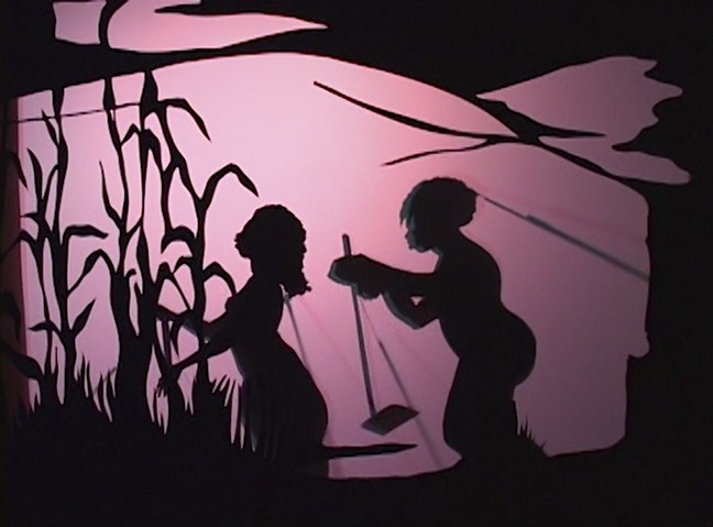 silhouettes of people outside on pink background