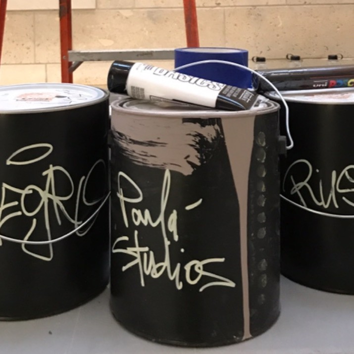 Paint cans in artist studio