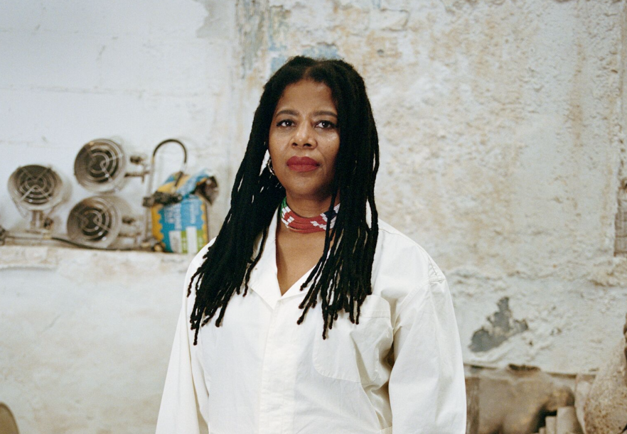 A photo of artist Simone Leigh in her studio