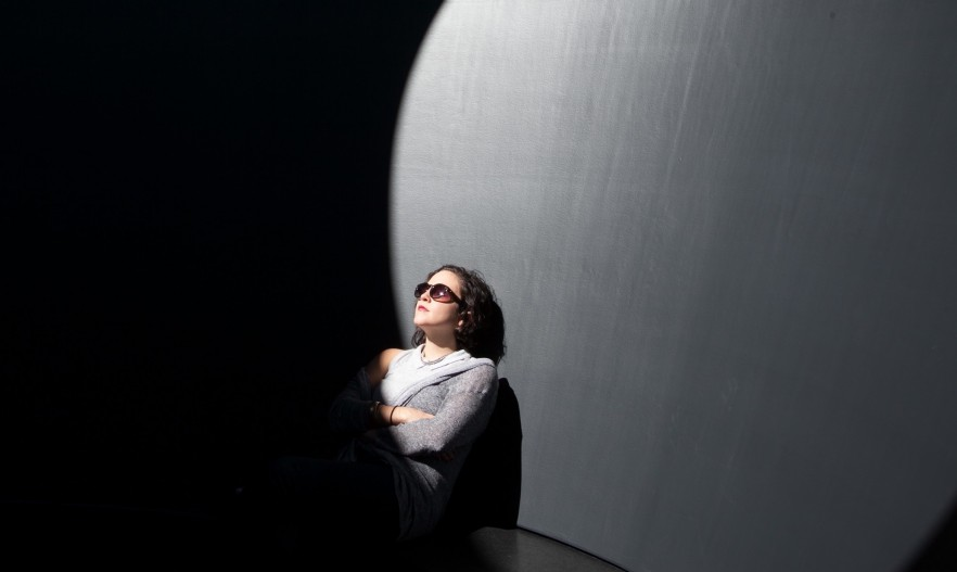 woman in skyspace with sunglasses