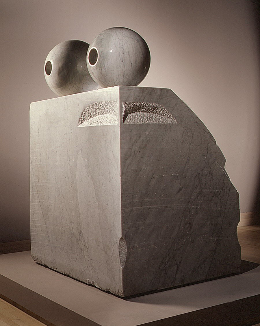 A large rectangular marble sculpture with spheres on top