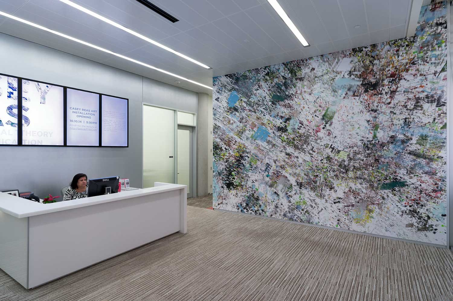 An office with a large wall mural