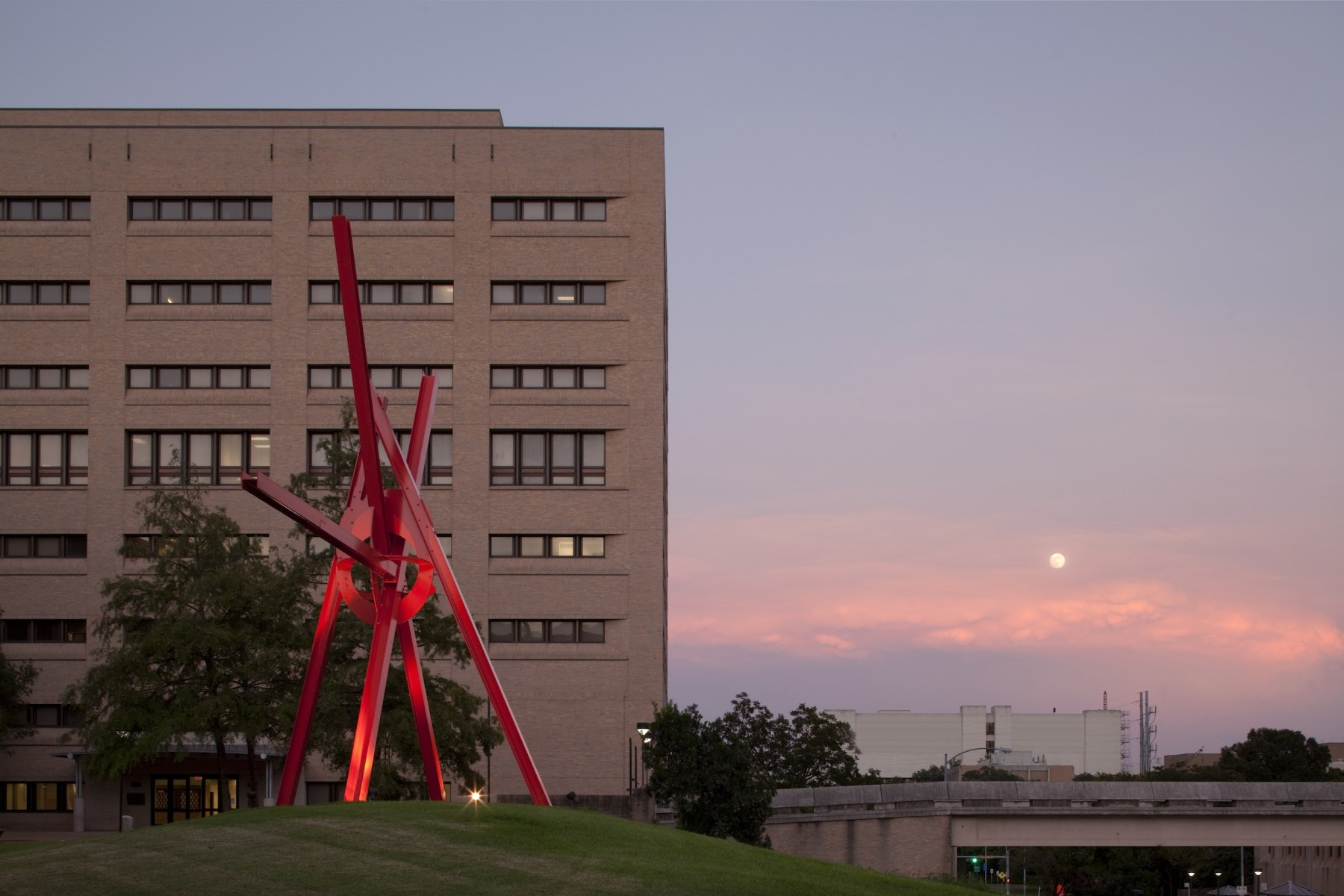 A large sculpture with the sunset in the background