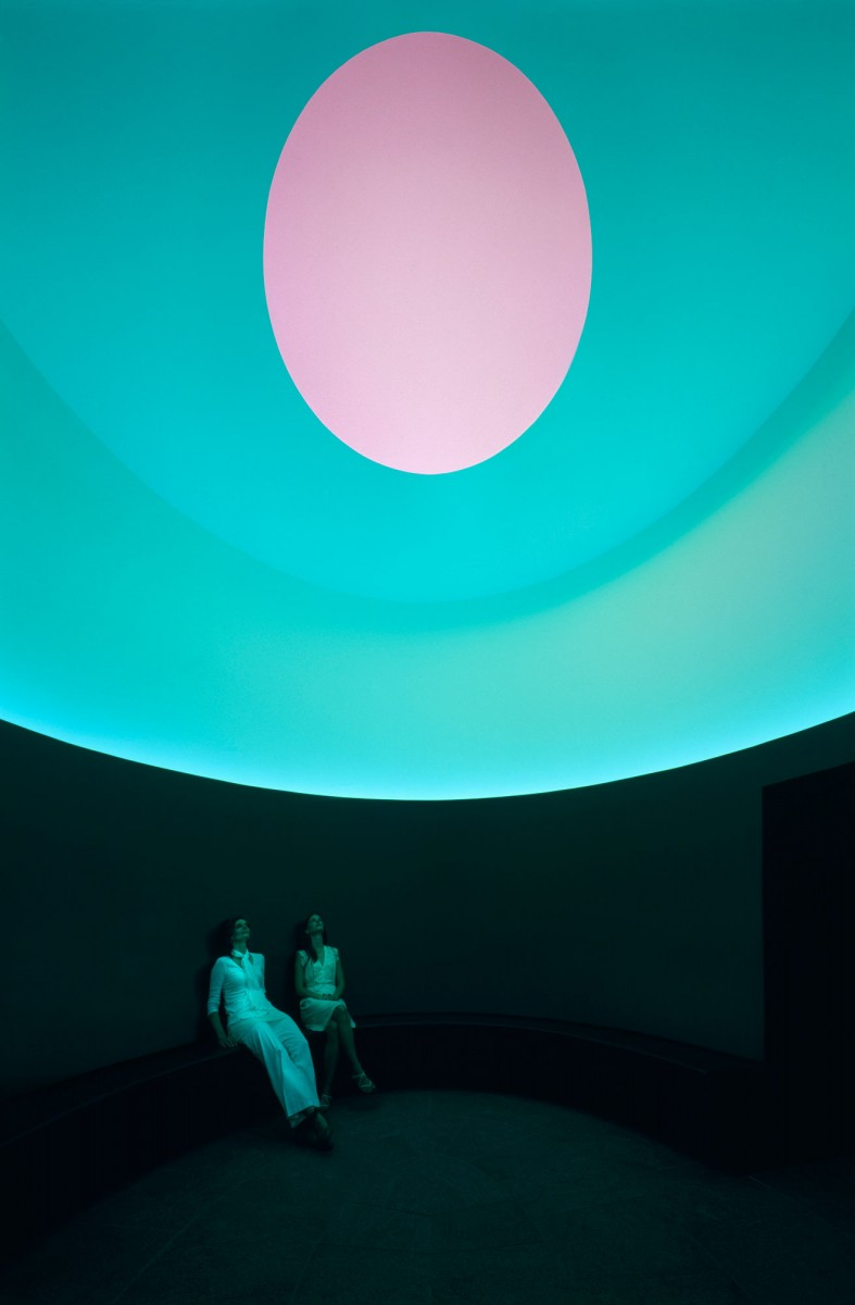 Two figures inside a cylindrical room with an oculus overhead