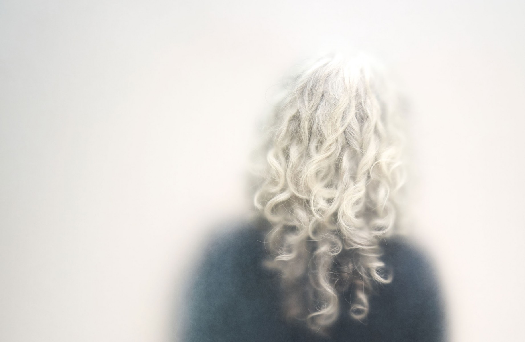 A woman with curly silver hair