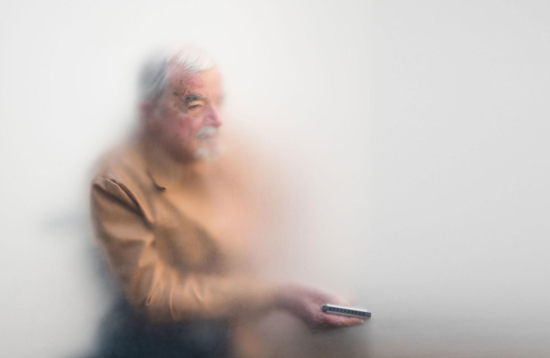 An older man in a wheelchair