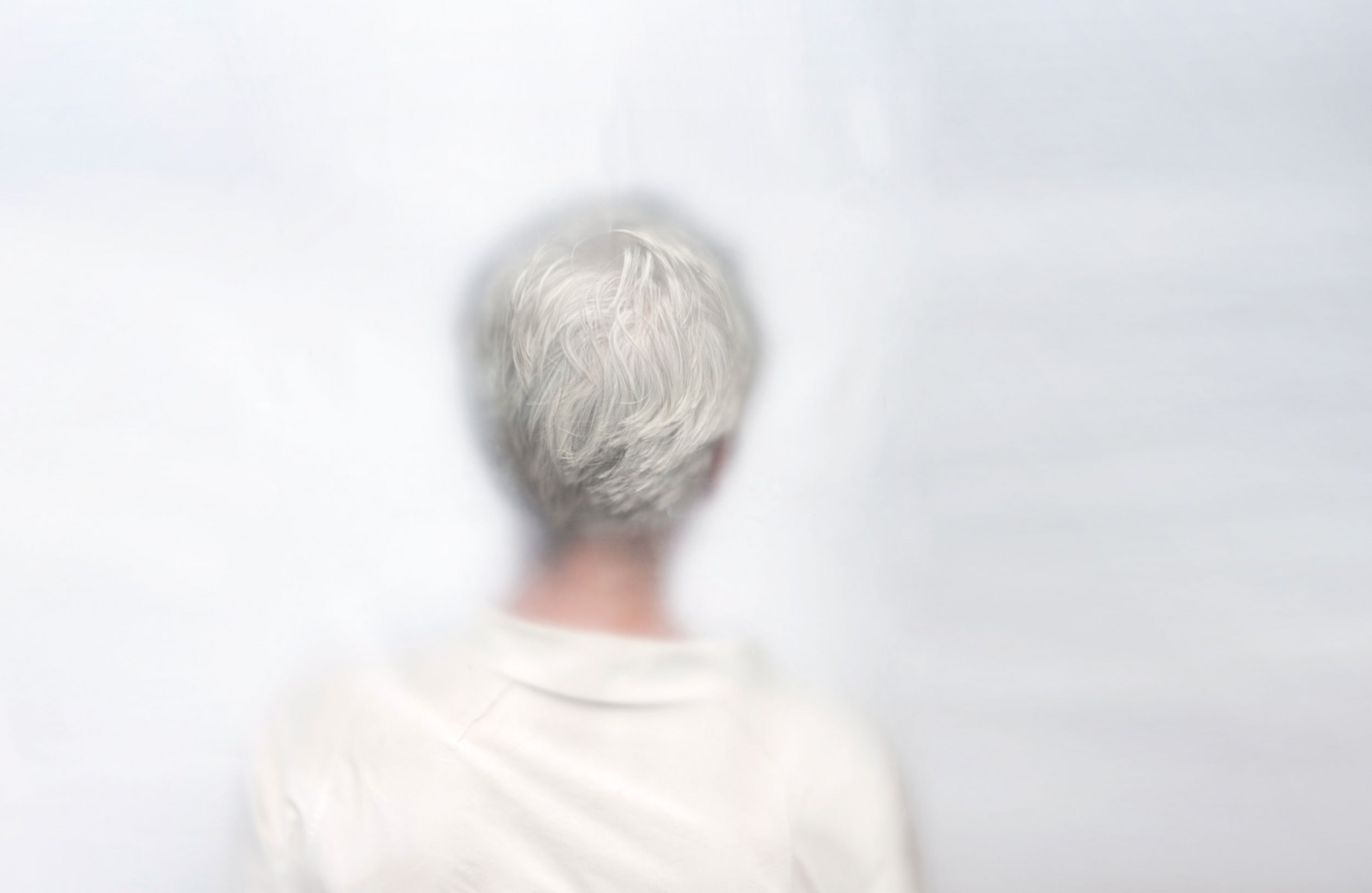 A woman with shirt grey hair