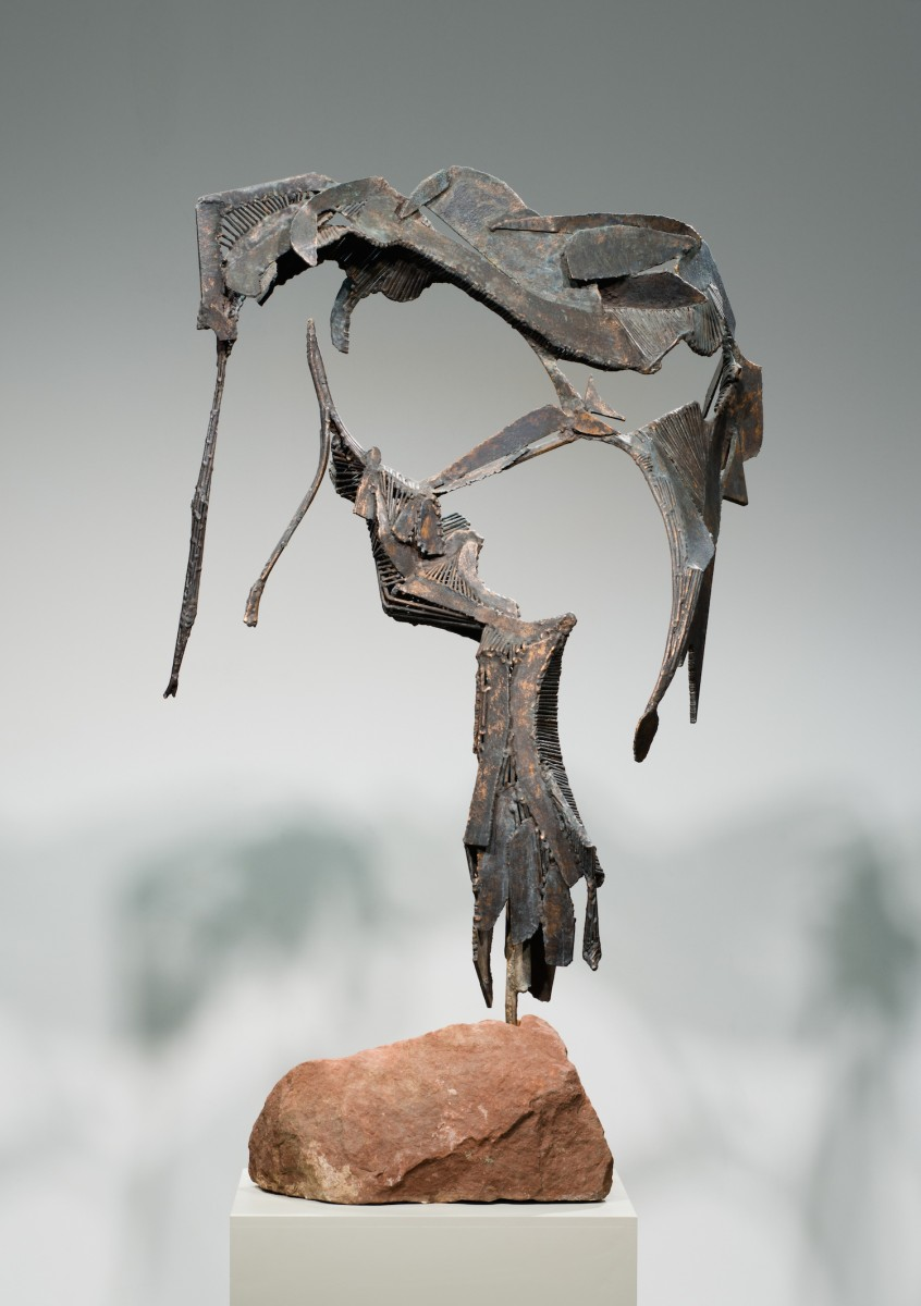 A sculpture mounted on a rock