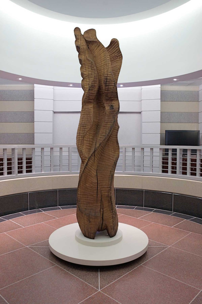 A cherry wood sculpture in a large rotunda